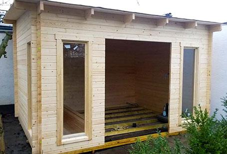 Referenzen Außen Gartenhäuser aus Holz Aufbau von HolzLand Bunzel in Marl und Hamm